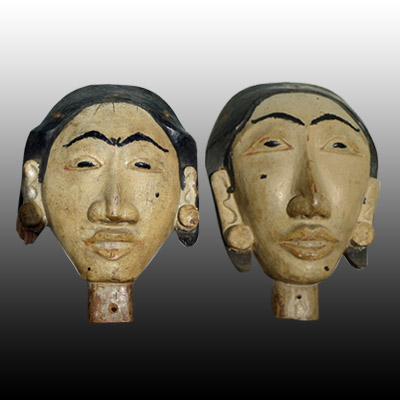 Bali male and female anamist head carvings