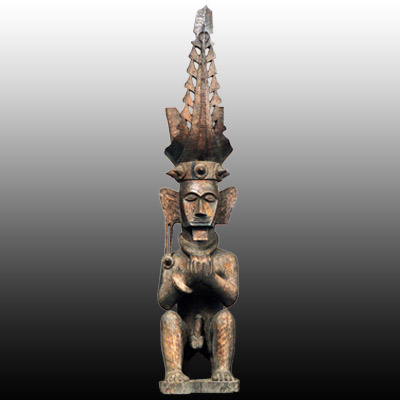 Nias Island male ancestor figure seated and holding a cup in both hands