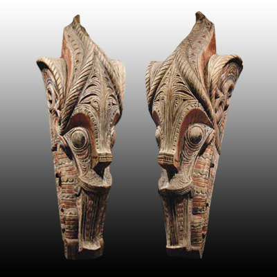 Large pair of Singa-Singa heads taken from a Batak Toba house gable