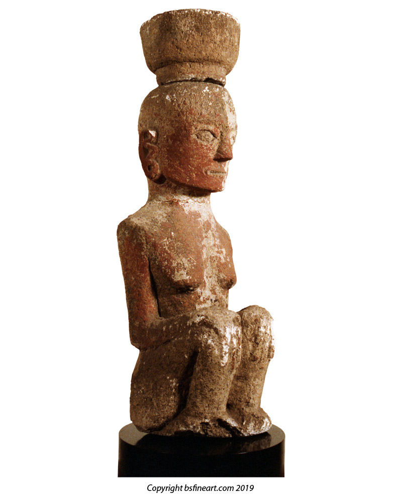 Batak Toba stone femal figure in seated position