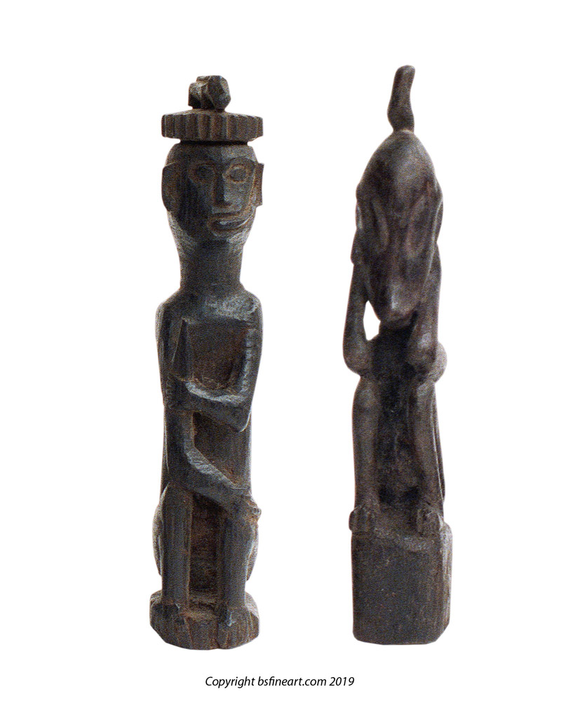 Two Dayak wooden charms