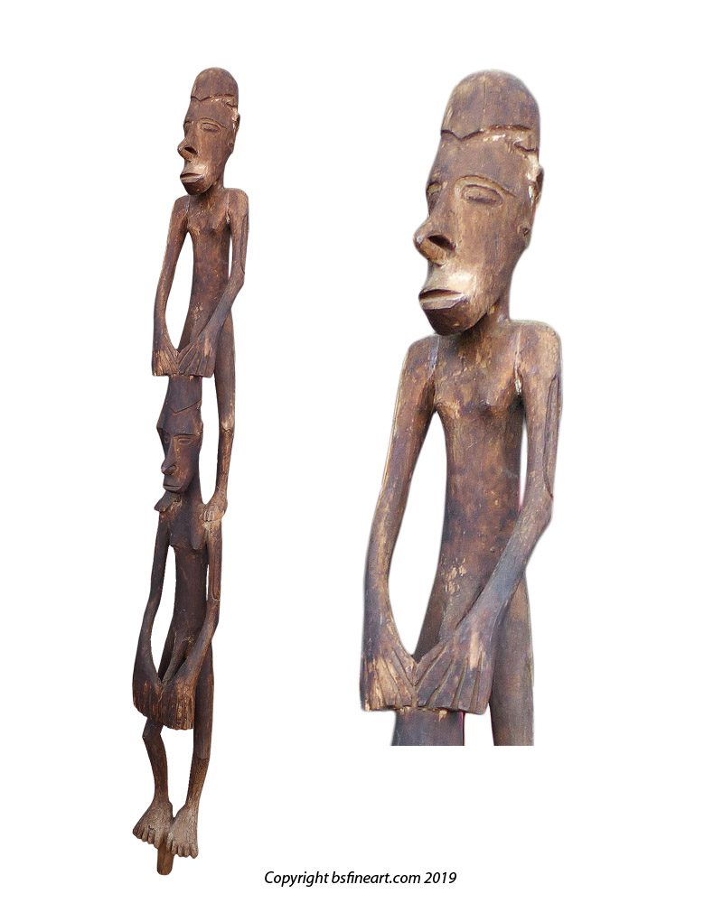 Asmat double canoe sculpture showing two male figures