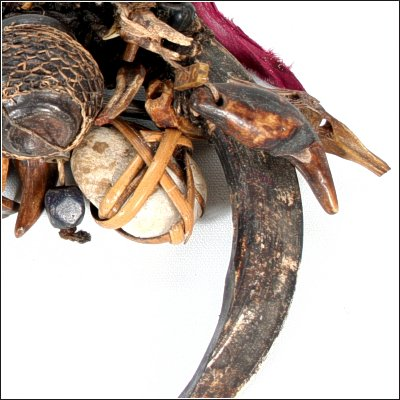 Dayak ritual garland with tusk