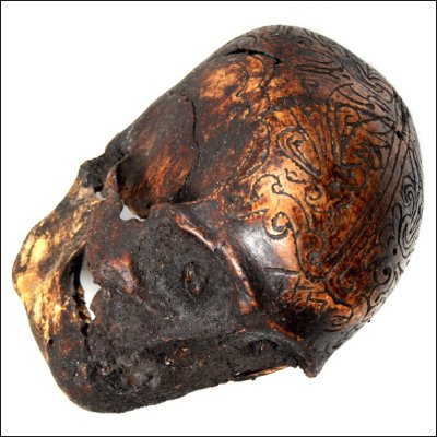 Dayak human trophy skull with carved cranium and eyes set with pitch