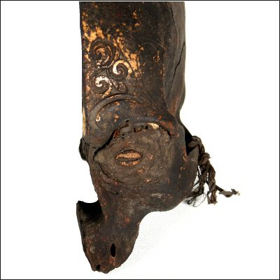 Dayak human trophy half skull with carved cranium and eyes set with pitch