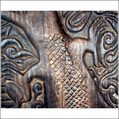 West Kalimantan Dayak Longhouse door finely carved with a crocodile